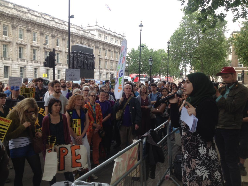 muzna speaking at migrant rights rally