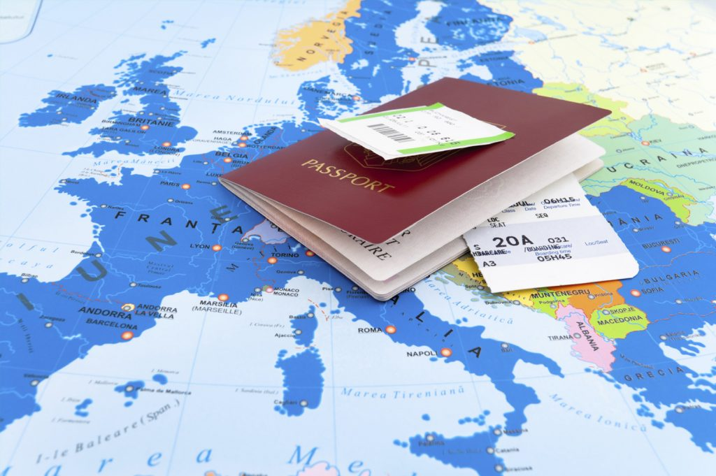 EU passport and map of europe